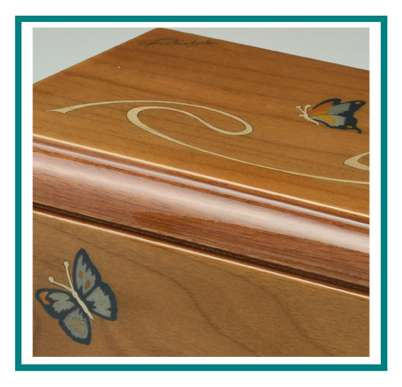 rotastyle cremation urn sunlit wings Bolivian walnut engraving detail1